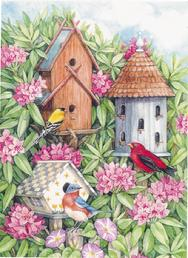 3 birdhouses with flowers and birds