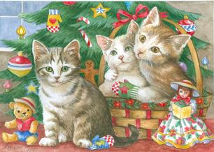 Kittens in basket and in front of tree with mittens